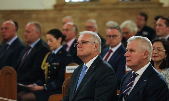 Prime Minister Scott Morrison and Deputy Prime Minister Michael McCormack attend a Parliamentary church service at the St Christopher's Catholic Cathedral in Manuka in Canberra, Australia on Feb. 2, 2021. (Dominic Lorrimer/Pool/Getty Images)