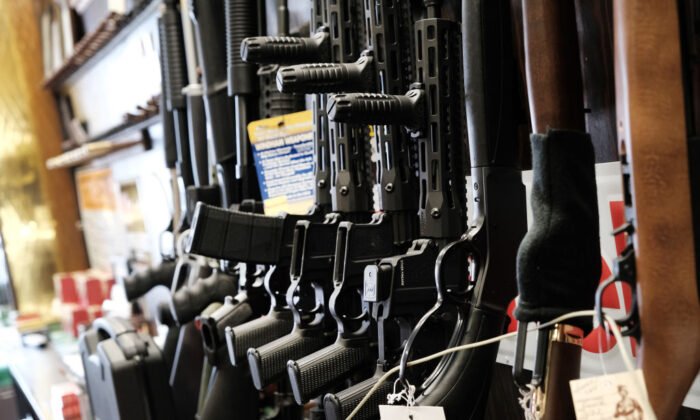 Few rifles remain on the shelf at Caso's Gun-A-Rama store in Jersey City, N.J., on March 25, 2021. (Spencer Platt/Getty Images)