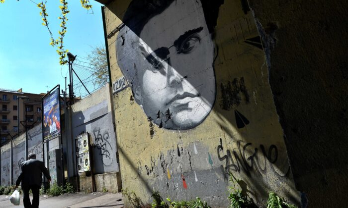 A graffiti by Italian artist Ozmo depicting Italian communist Antonio Gramsci covers a wall in Rome on March 31, 2014. (Alberto Pizzoli/AFP via Getty Images)