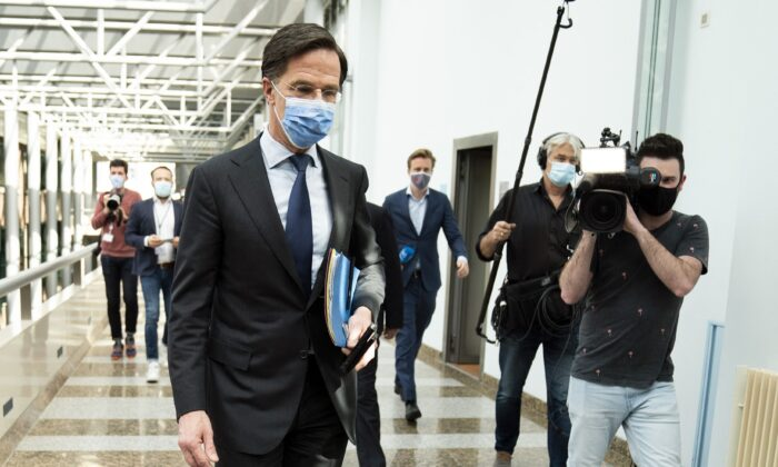 Dutch outgoing Prime Minister Mark Rutte of the VVD party leaves during a suspension of a debate at the Parliament's Lower House in The Hague on April 1, 2021. (Bart Maat/ANP/AFP via Getty Images)