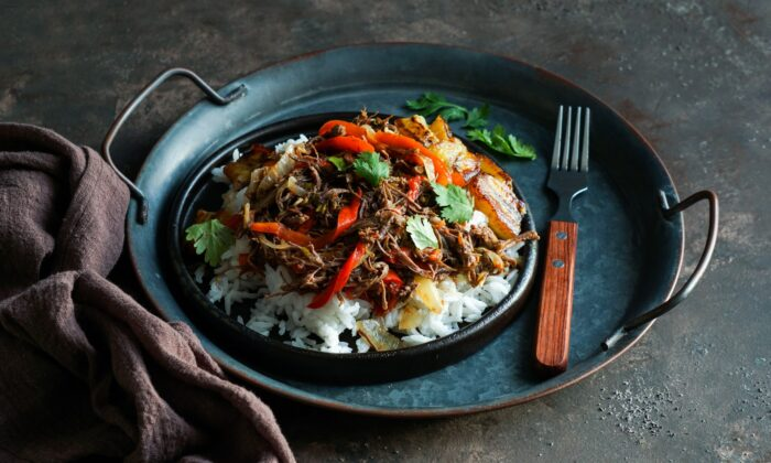 Cuba's version of this Spanish import braises beef in a lush tomato-based sauce until it can be shredded. (Julia-Bogdanova/shutterstock)
