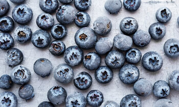 Frozen blueberries are ideal ice cubes: They get the job of cooling the drink done, then offer their soggy bodies as a sweet, tart finish. (ZOLDATOFF/shutterstock)
