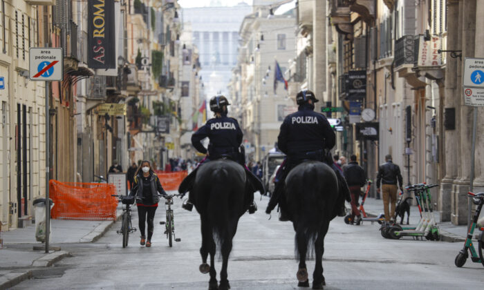 Mounted police officers patrol Via del Corso main shopping street in downtown Rome on April 3, 2021. (Gregorio Borgia/AP)