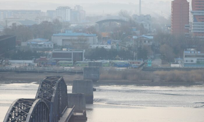 North Korea's Sinuiju and the Broken Bridge over the Yalu river are seen from Dandong, Liaoning province, China March 19, 2021.  (Carlos Garcia Rawlins/Reuters)