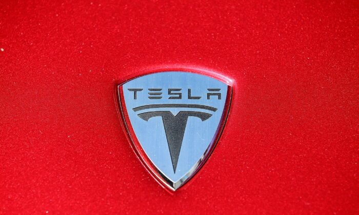 The Tesla Motors logo is seen on the hood of a car at Tesla Motors headquarters, in Palo Alto, Calif., in May 20, 2010. (Justin Sullivan/Getty Images)