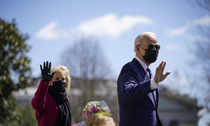 President Joe Biden, left, waves as he and First Lady Jill Biden leave the White House in Washington on April 2, 2021. (Drew Angerer/Getty Images)