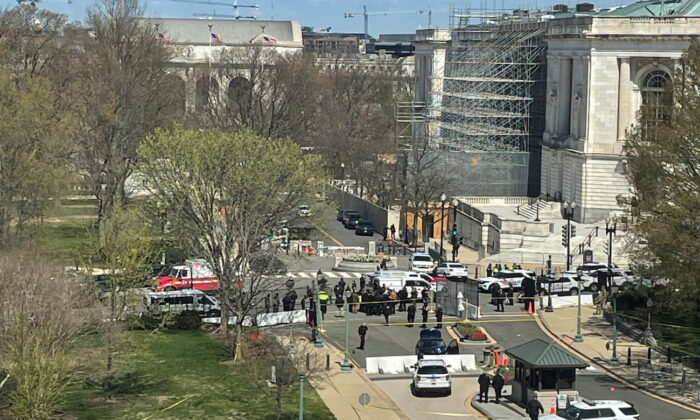 U.S. Capitol police surround a blue car that rammed a police barricade outside the U.S. Capitol building on Capitol Hill in Washington, on April 2, 2021. (Michael Weekes/Reuters)