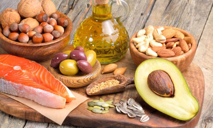 Avocado, olive oil, legumes, whole grains, nuts, seeds, fruits, and veggies are anti-inflamma- tory foods with healthy cholesterol. (Craevschii Family/Shutterstock)