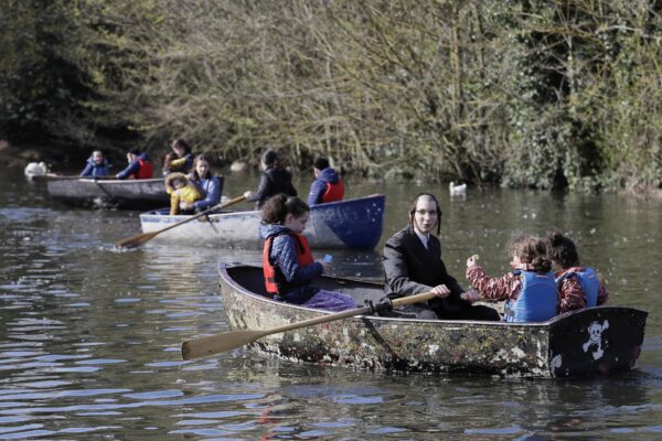 Families enjoy a boating lake in Finsbury Park
