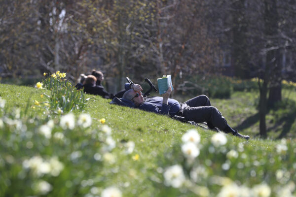People enjoy the sunny weather in Sefton Park in Liverpool