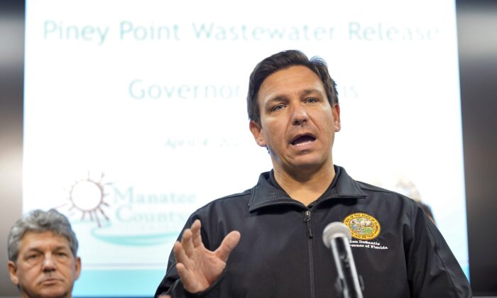 Florida Gov. Ron DeSantis gestures during a news conference at the Manatee County Emergency Management office in Palmetto, Fla., on April 4, 2021. (Chris O'Meara/AP Photo)