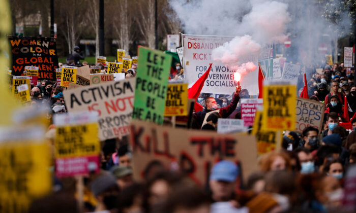 Demonstrators taking part in a 'Kill The Bill' protest against the government's Police, Crime, Sentencing, and Courts Bill hold up placards as they march in central London on April 3, 2021. (Tolga Akmen/AFP via Getty Images)