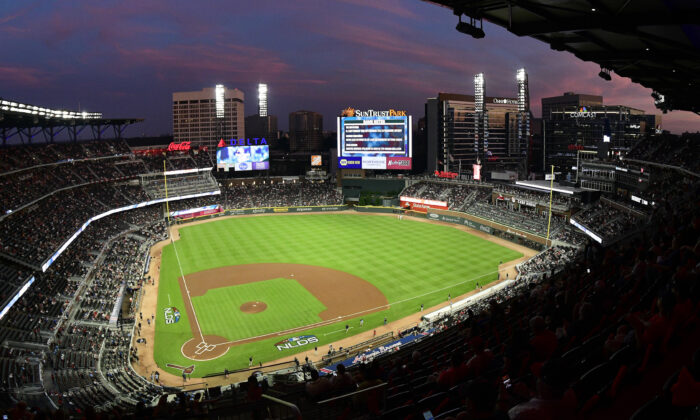 Ground crews prepare the field at Sun Trust Park ahead of Game 3 of MLB baseball's National League Division Series between the Atlanta Braves and the Los Angeles Dodgers, in Atlanta, Ga., on Oct. 7, 2018. (John Amis/AP Photo)