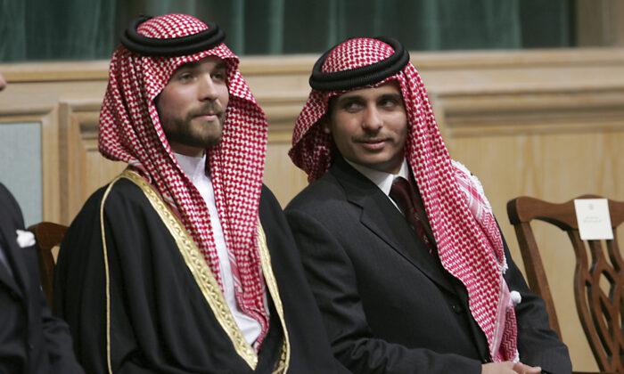 Prince Hamza Bin Al-Hussein (R) and Prince Hashem Bin Al-Hussein (L), brothers of King Abdullah II of Jordan, attend the opening of the parliament in Amman, Jordan, on Nov. 28, 2006. (Mohammad abu Ghosh/AP Photo)