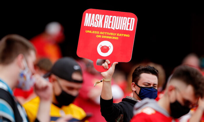 Spectators are reminded of mask requirements as the Kansas City Chiefs play the Carolina Panthers at Arrowhead Stadium in Kansas City, Mo., on Nov. 8, 2020. (David Eulitt/Getty Images)