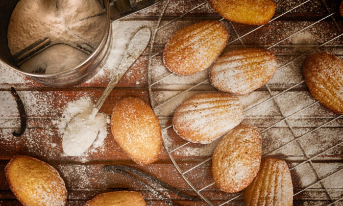 Buttery, lemon-scented, and browned and crispy on the outside while spongy and soft on the inside, madeleines are a lovely homemade treat. (Kremena Ruseva/Shutterstock)