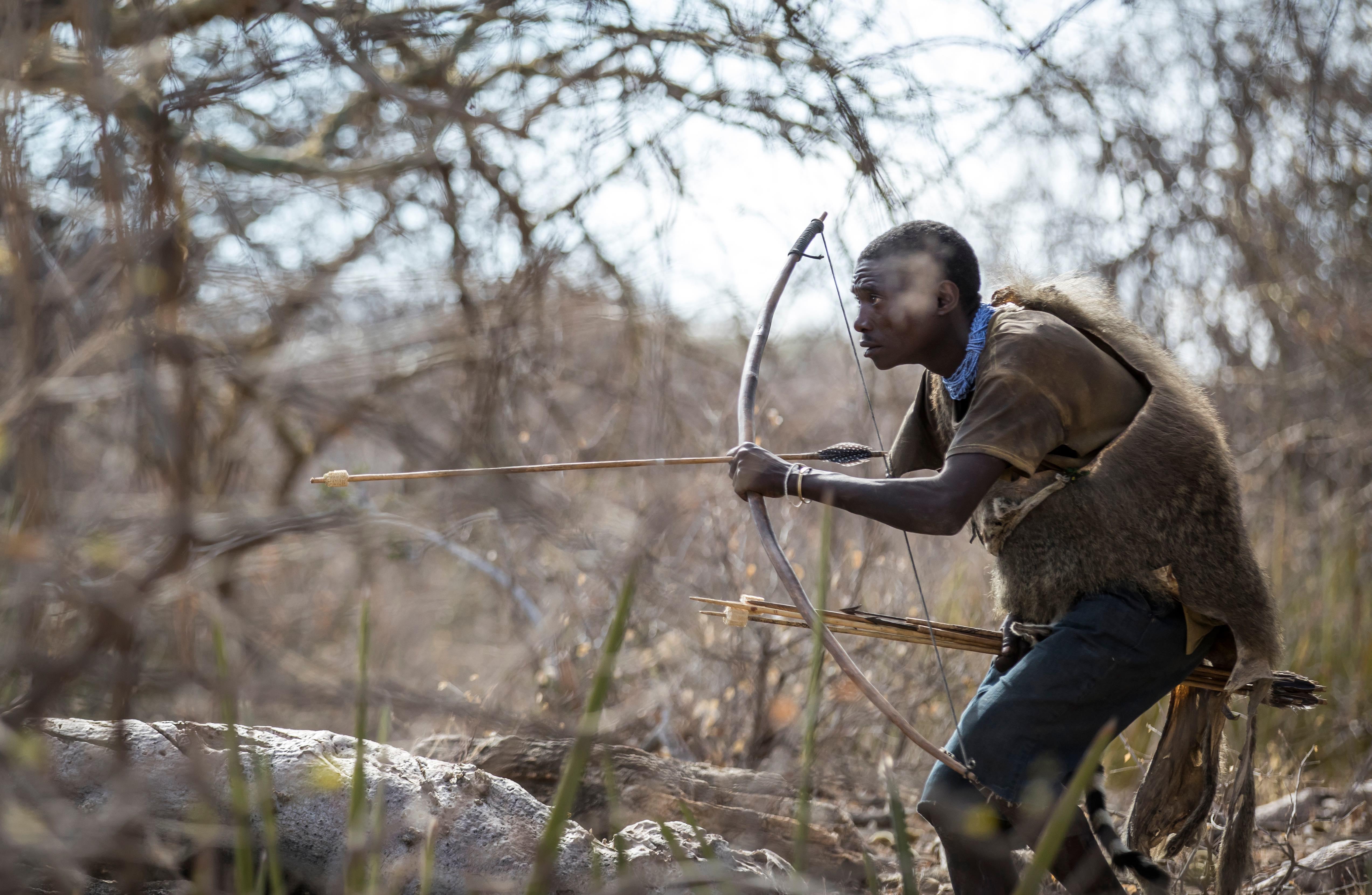 Hadzabe hunter in the nature of norther Tanzania. (Katiekk/Shutterstock)