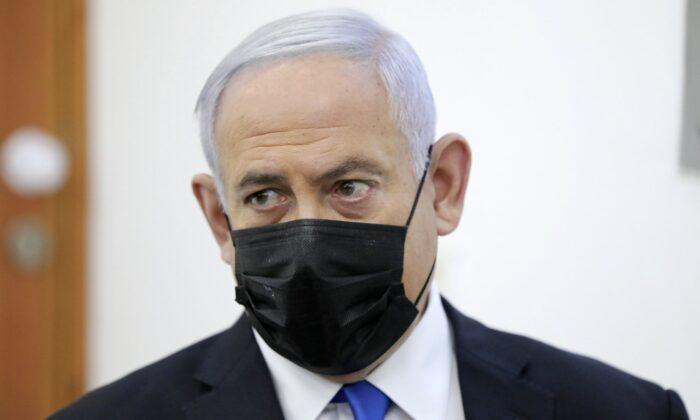 Israeli Prime Minister Benjamin Netanyahu attends a hearing evidence stage for his trial over alleged corruption crimes, at the Jerusalem district court, in Salah El-Din, East Jerusalem, on April 5, 2021. (Abir Sultan/Pool Photo via AP)