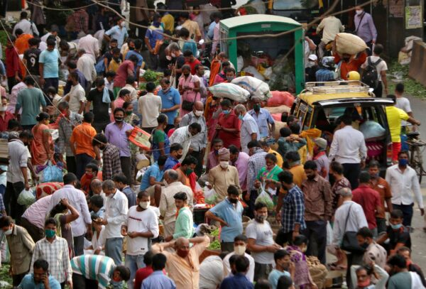 People shop at a crowded marketplace