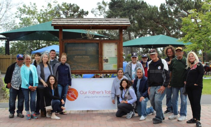Our Father's Table volunteers gather during a pre-COVID event in San Juan Capistrano. (Courtesy of Our Father's Table)