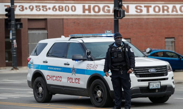 Chicago police officers investigate a shooting in Chicago, Ill., on March 14, 2021. (Kamil Krzaczynski/AFP via Getty Images)