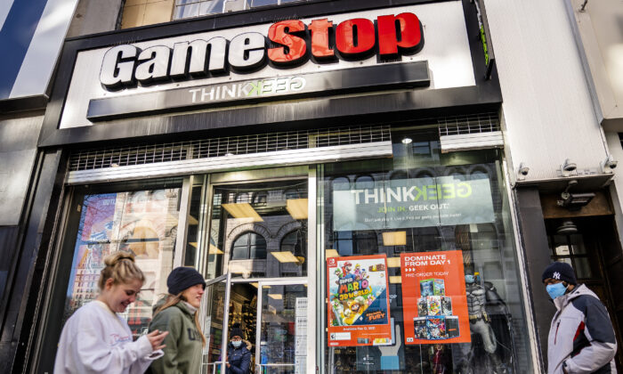 In this file photo, pedestrians pass a GameStop store on 14th Street at Union Square, in the Manhattan borough of New York, on Jan. 28, 2021. (AP Photo/John Minchillo, File)