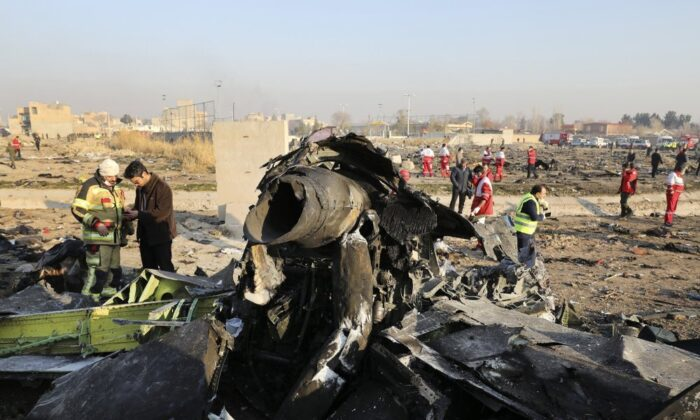FILE - In this Jan. 8, 2020, file photo, debris at the scene where a Ukrainian plane crashed in Shahedshahr southwest of the capital Tehran, Iran. Iranian media are quoting the outgoing military prosecutor of Tehran as saying that 10 officials have been indicted for the 2020 shootdown of a Ukrainian passenger plane. (AP Photo/Ebrahim Noroozi, File)