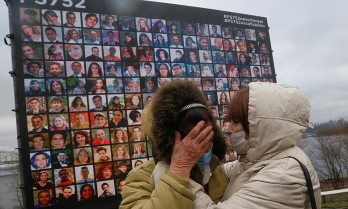 Relatives react at a memorial in Kyiv, Ukraine, on Jan. 8, 2021, for the victims of a Ukrainian 737-800 plane crash on the outskirts of Tehran.Ten officials have been indicted in Iran over the 2020 military shootdown of a Ukrainian passenger plane that killed 176 people, but the move did nothing to quell Canadian demands for accountability on April 6. (Efrem Lukatsky/The Canadian Press/AP)