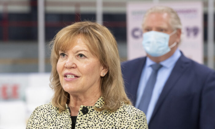 Ontario Health Minister Christine Elliott speaks during the daily briefing at a mass vaccination centre in Toronto, Canada, on March 30, 2021. (Frank Gunn/The Canadian Press)