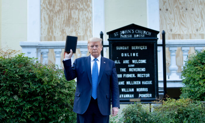 Then-President Donald Trump holds a Bible while visiting St. John's Church across from the White House, which had been damaged by riots, in Washington on June 1, 2020. (Brendan Smialowski/AFP via Getty Images)