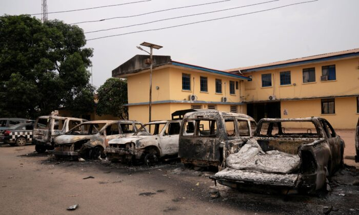 Burnt vehicles are seen outside the Nigeria police force Imo state command headquaters after gunmen attacked and set properties ablaze in Imo State, Nigeria, on April 5, 2021. (David Dosunmu/Handout via Reuters)