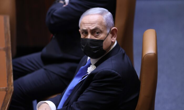 Israeli Prime Minister Benjamin Netanyahu attends the swearing-in ceremony for Israel's 24th government, at the Knesset, or parliament, in Jerusalem, Israel, on April 6, 2021. (Alex Kolomoisky/Pool via AP)