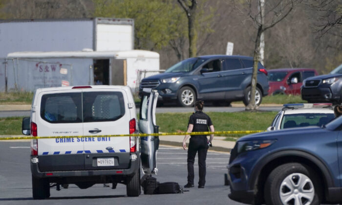 A crime scene technician stands near the scene of a shooting at a business park in Frederick, Md., on April 6, 2021. (Julio Cortez/AP Photo)