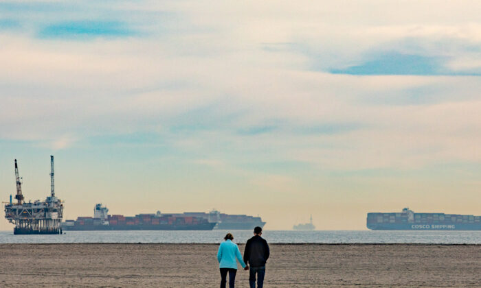 Ships line the horizon seen from Seal Beach, Calif., as they await to come ashore to The Port of Los Angeles, on Jan. 12, 2021. (John Fredricks/The Epoch Times)