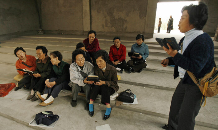 Ethnic Korean Christians sing hymns in their half-finished church in the town of Yanji in Yanbian Korean Autonomous Prefecture on the China/North Korea border on Oct. 13, 2006. (PETER PARKS/AFP via Getty Images)
