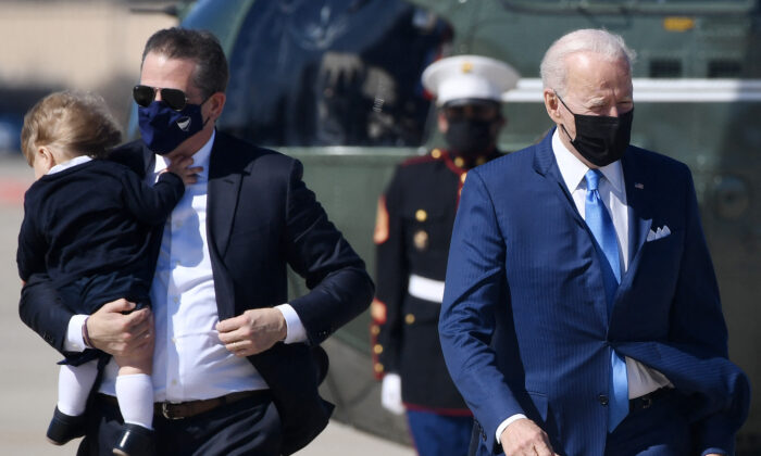 Hunter Biden, left, travels with President Joe Biden to board Air Force One at Joint Base Andrews, Md., on March 26, 2021. (Olivier Douliery/AFP via Getty Images)