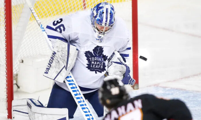 Toronto Maple Leafs goalie Jack Campbell makes a save on Calgary Flames' Sean Monahan during the second period of Toronto's 5-3 road win on the night of April 5 in Calgary. (Larry MacDougal/The Canadian Press)