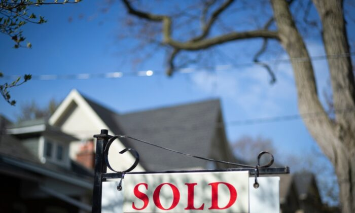 "A real estate ""sold"" sign is shown in a Toronto west end neighbourhood on May 17, 2020. (Graeme Roy/The Canadian Press)"