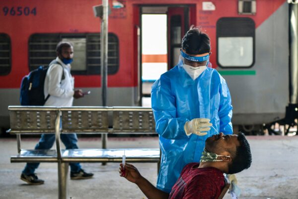 A health worker collects a sample