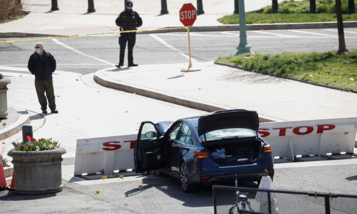 A blue car is seen after ramming a police barricade outside the U.S. Capitol building, in Washington on April 2, 2021. (Tom Brenner/Reuters)