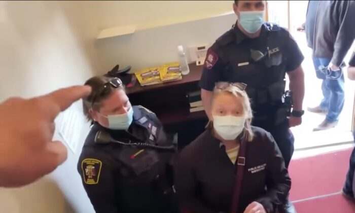 Pastor Artur Pawlowski orders police on a COVID-19 check to leave The Fortress (Cave) of the Adullam congregation in Calgary, Canada, on Holy Saturday, April 3, 2021. (Screenshot Youtube via The Epoch Times)