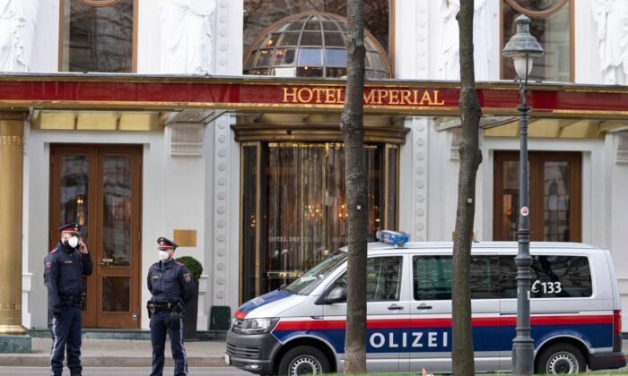 Police officers stand in front of Hotel Imperial where a delegation from Iran is staying in Vienna, Austria, on April 6, 2021. (Florian Schroetter/AP Photo)