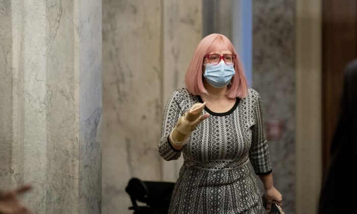 Sen. Kyrsten Sinema (D-Ariz.) walks on Capitol Hill in Washington on Dec. 11, 2020. (Stefani Reynolds/Getty Images)