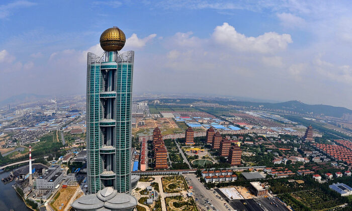 One of China's tallest buildings, the $470 million Longxi International Hotel, touted by Chinese officials as a symbol of China's economic growth, stands at 328 metres (1,082-feet) high in Huaxi, Jiangsu province, on Sept. 25, 2011. (AFP via Getty Images)
