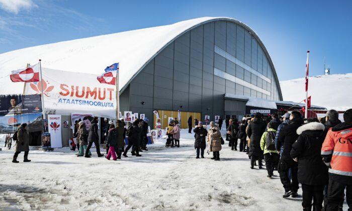 People line up to vote in the Inussivik arena in Nuuk, Greenland, on April 6, 2021. (Emil Helms/Ritzau Scanpix via AP)