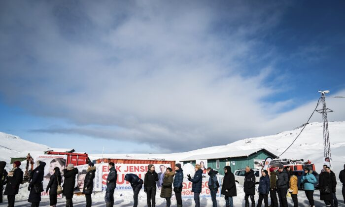 People queue to vote, in the Inussivik arena in Nuuk, Greenland, on April 6, 2021. (Emil Helms/Ritzau Scanpix via AP)