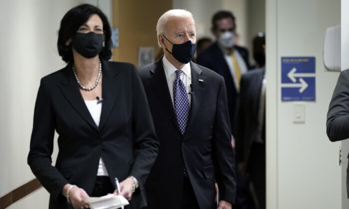 Dr. Rochelle Walensky, director of the Centers for Disease Control and Prevention, leads President Joe Biden into the room for a COVID-19 briefing at the headquarters for the CDC in Atlanta, Ga., on March 19, 2021. (Patrick Semansky/AP Photo)