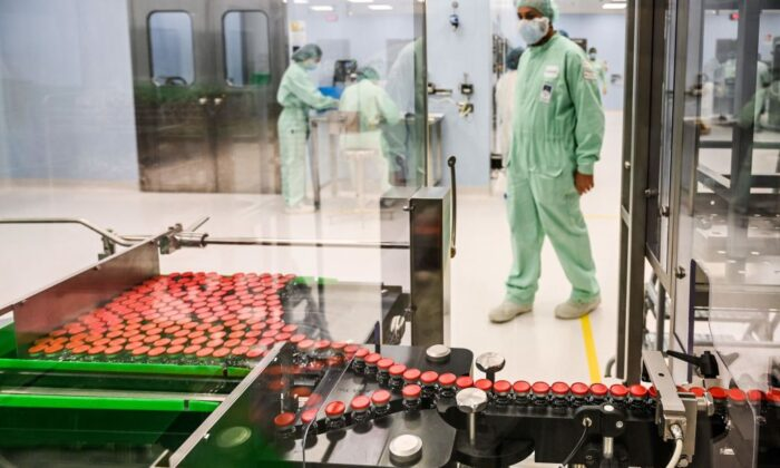 A laboratory technician supervises the large-scale production and supply of the University of Oxfords AstraZeneca COVID-19 vaccine at the Italian biologics manufacturing facility in Anagni, Italy, on Sept. 11, 2020. (Vincenzo Pinto/AFP via Getty Images)