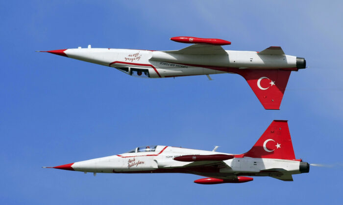 Members of Turkish Stars display team present their exercise with their NF-5 type aircraft in a file photo. (Viktkor Veres/AFP via Getty Images)