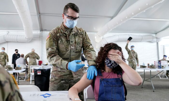 People receive the Pfizer COVID-19 vaccine at a FEMA vaccination center at Miami Dade College in Miami on April 5, 2021. (Lynne Sladky/AP Photo)